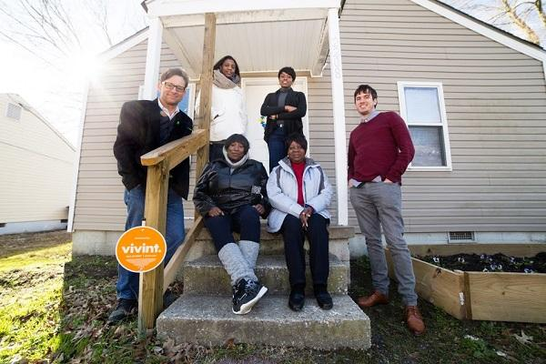 photo of 6 people on the front steps of a house