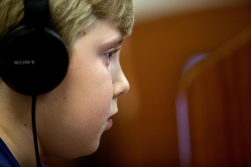 Chandler White works intently on a computer program in the school computer lab. Chandler White, 8, struggles with dyslexia, attends The Piedmont School, a non-profit school specializing in teaching students with learning disabilities.