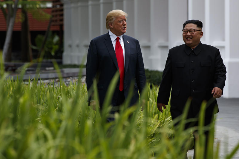 President Donald Trump Walks with North Korea leader Kim Jong Un