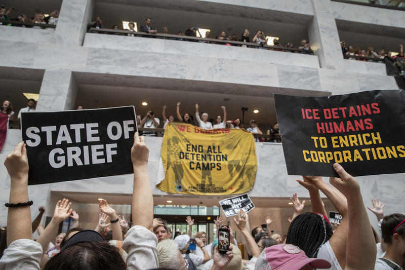 Hundreds of activists protest the Trump administration's approach to illegal border crossings and separation of children from immigrant parents, in the Hart Senate Office Building on Capitol Hill in Washington, Thursday, June 28, 2018.