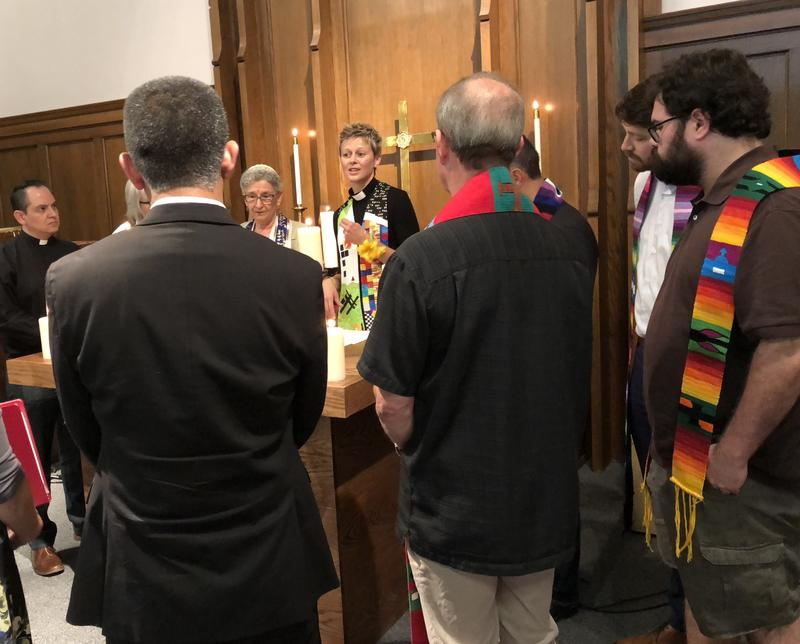Rev. Jenny Shultz-Thomas, of Community United Church of Christ, leads a prayer with area clergy on Wed., June 20, 2018 at One Table United Methodists Church in Raleigh.