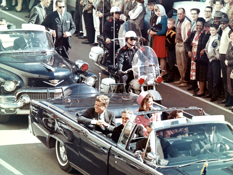 President John F. Kennedy in the motorcade where he was assassinated, with Texas Governor John Connally sitting in front of him.
