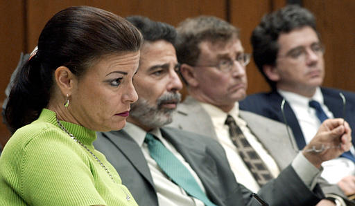 This photo, taken in 2003, shows then-Assistant District Attorney Freda Black on the left as she sat alongside defense attorney David Rudolf, second from left, defendant Michael Peterson and assistant defense attorney Tom Maher, right, during a hearing at