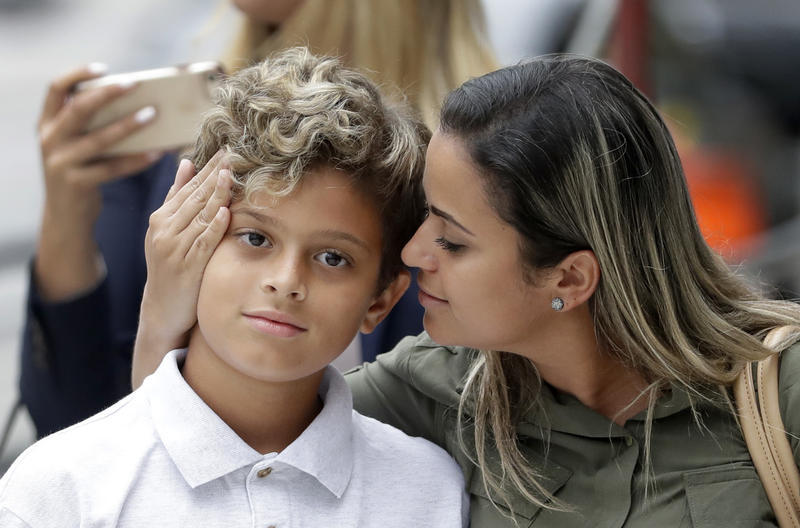 Sirley Silveira Paixao, an immigrant from Brazil seeking asylum, looks at her 10-years-old son Diego Magalhaes, after Diego was released from immigration detention Thursday, July 5, 2018, in Chicago.