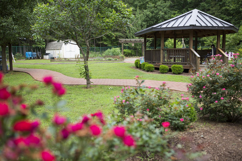 A memorial brick walkway winds through the garden at the women's campus of Healing Transitions, a residential recovery program, in Raleigh.