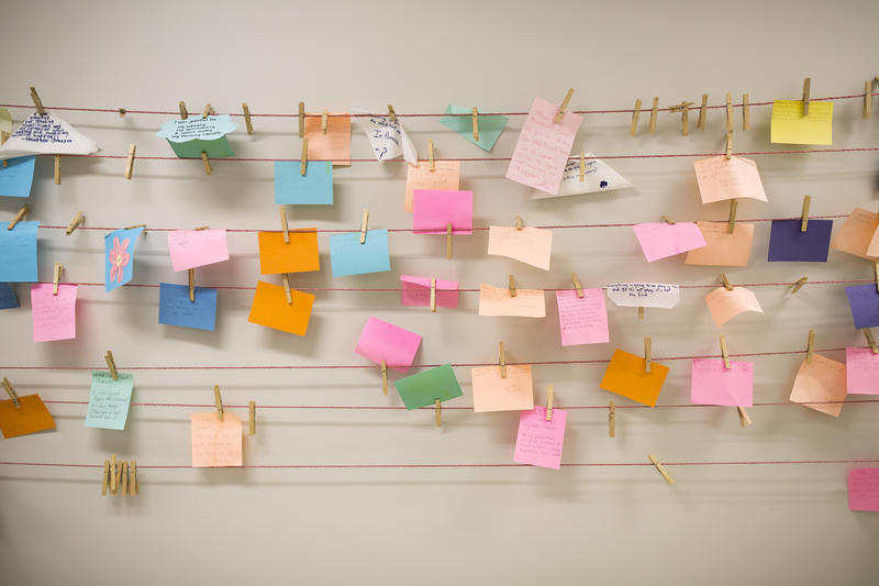 Notes stating what women in recovery are grateful for hang on a clothesline at Healing Transitions in Raleigh.