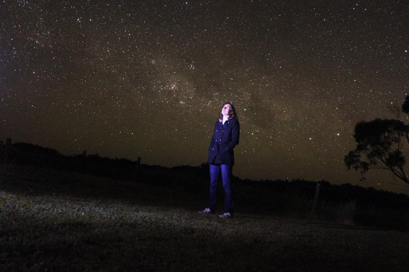 picture of Katie Mack staring up immersed in stars
