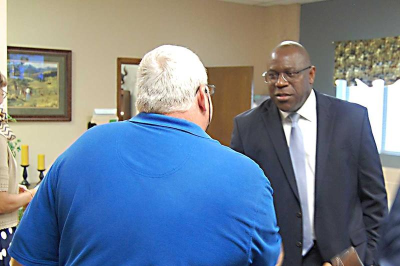 Bruce Major, left, met with community leaders in Robeson County Thursday. He will serve as the head administrator of Southside-Ashpole Elementary in Robeson County, as part of the state's new Innovative School District.