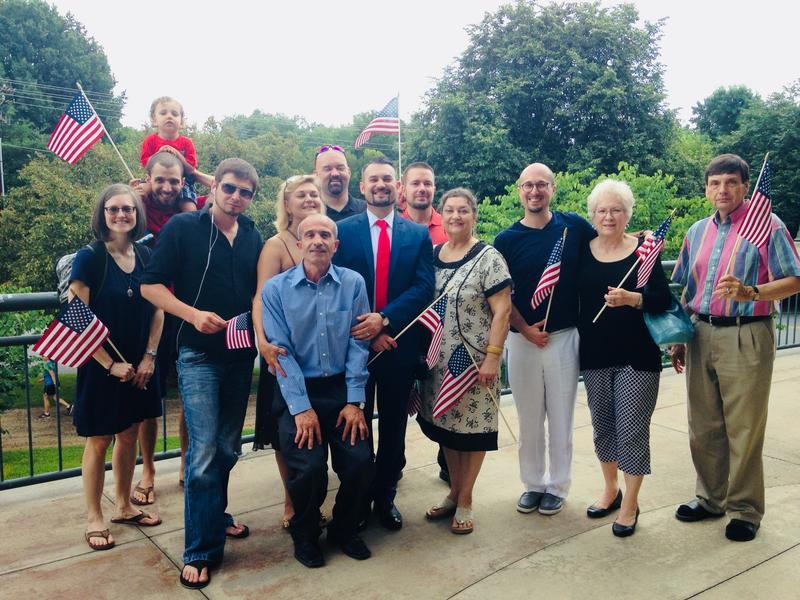 Anton Moussaev, center, stands with family and friends after his naturalization ceremony in 2017.