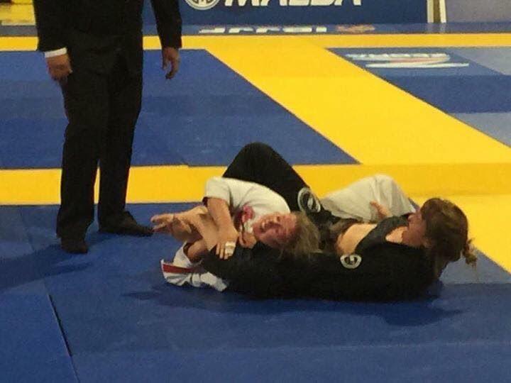 Kim Rice wrestling her opponent