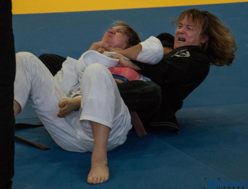 Kim Rice has her opponent in choke hold.