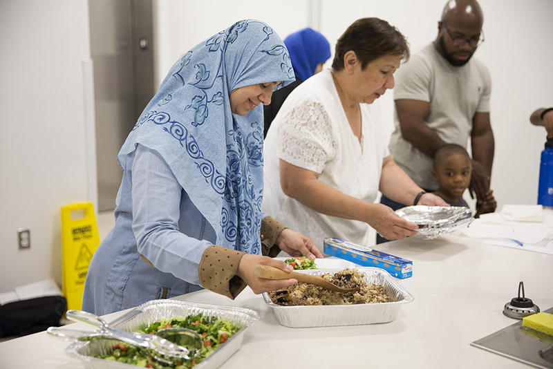 Shereen Abdelfattah, left, Esmirna Esparza, and a guest fix plates of food for Dexter Jason and Landon Jason, 4, following a cooking demonstration at the Forsyth County Library, on Saturday, July 21, 2018, Winston-Salem, N.C. A native of Egypt, Shereen Ab
