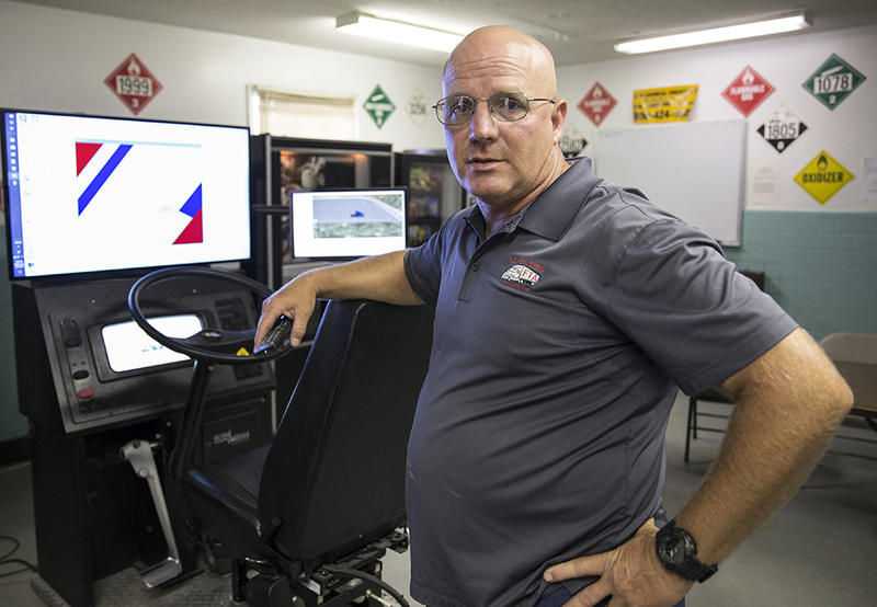 Jeff Cook, vice president of Future Truckers of America, readies one of the two truck driving simulators for students to use Wednesday, June 13, 2018, in Asheboro, N.C.