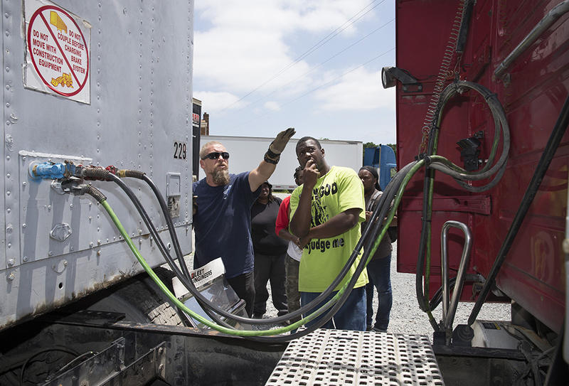 Student, Jimmy Haddock, left, helps Quenten Lee with identifying the parts of a tractor and trailer during a check list exercise for a pre-trip inspection upcoming exam at Future Truckers of America, truck driving school on Wednesday, June 13, 2018.