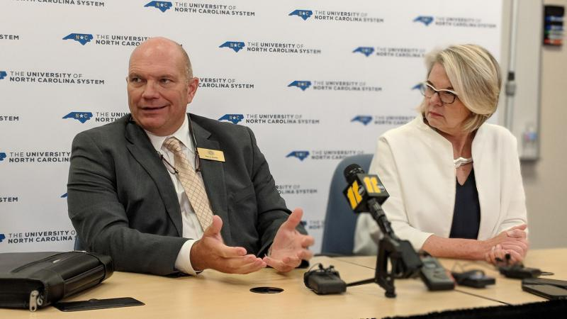File photo of UNC Board of Governors Chairman Harry Smith and UNC system President Margaret Spellings responding to questions about the aborted Western Carolina University chancellor search at a July 27, 2018 press conference.