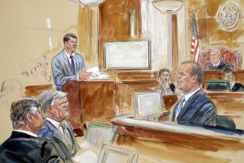 Rick Gates, right, testifying during questioning by prosecutor Greg Andres, standing at left, as former Trump campaign chairman Paul Manafort, far left, sits with his lawyer Kevin Downing as Manafort's trial continues at federal court in Alexandria, Va.