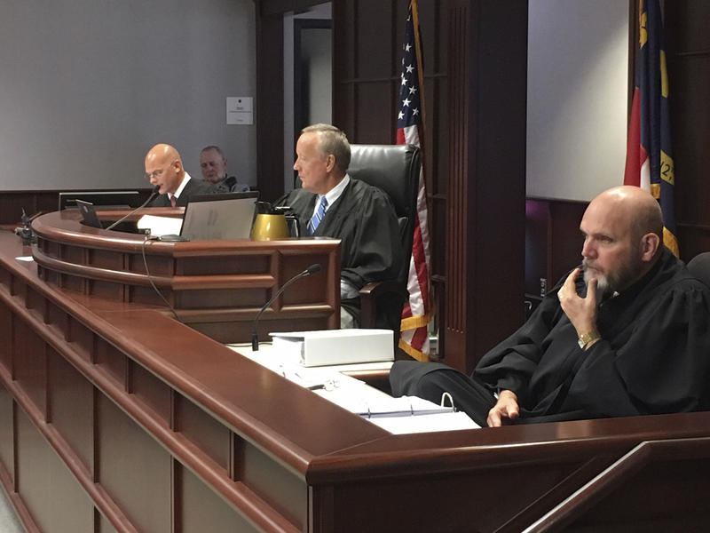 A trio of North Carolina judges in Raleigh, N.C., listen Wednesday, Aug. 15, 2018, as attorneys argue whether proposed amendments to the North Carolina constitution were worded to be misleading and mask the goal of Republican legislators to reduce Democra