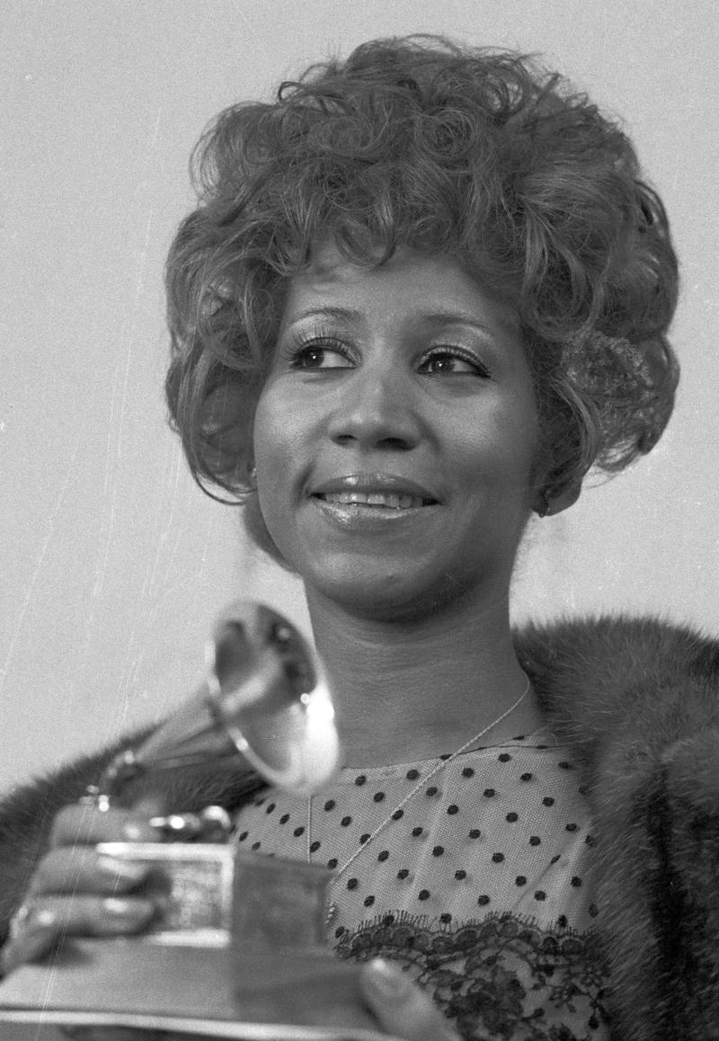 Queen of soul Aretha Franklin holds her Grammy Award for Best Rhythm and Blue performance of the song 'Bridge Over Troubled Waters,' March 13, 1972, in New York.
