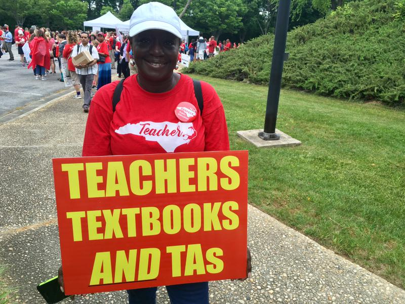Colavito Tyson is a teacher assistant at Nash-Rocky Mount Schools. She came to the May #Red4Ed march in Raleigh carrying this sign that she says she's had for years, from another educators' march calling for more school funding years ago.