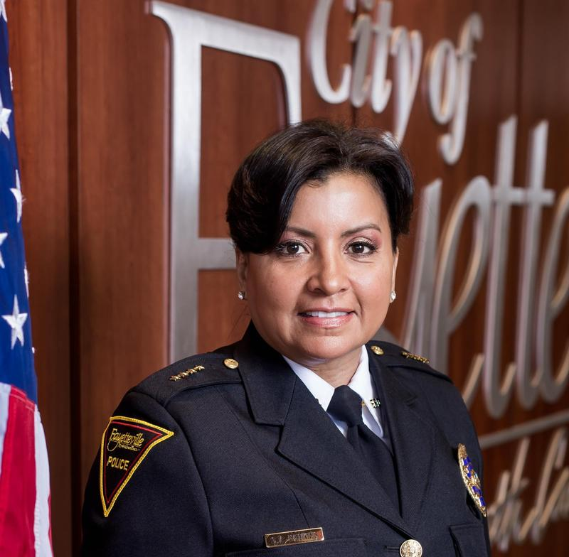 a headshot of Gina Hawkins in uniform
