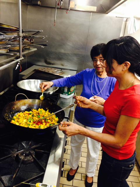 Cheetie Kumar preparing food with her mother in the kitchen at Garland restaurant.