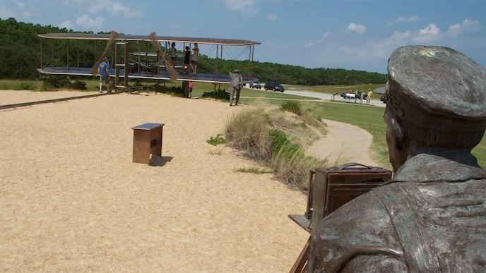 Sculpture of the Wright Brothers first flight at the Wright Brothers National Memorial in Kill Devil Hills