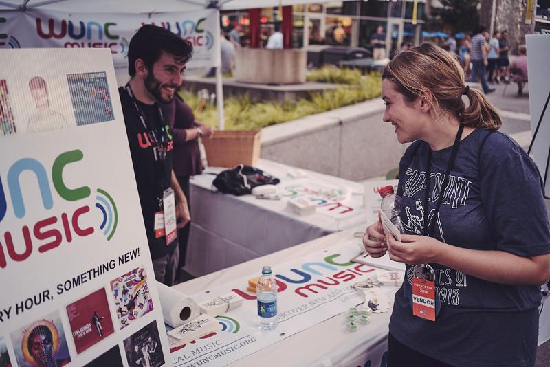 From the WUNC Tent at Hopscotch 2018 (Josh Altman in the WUNC Music t-shirt with music fan)