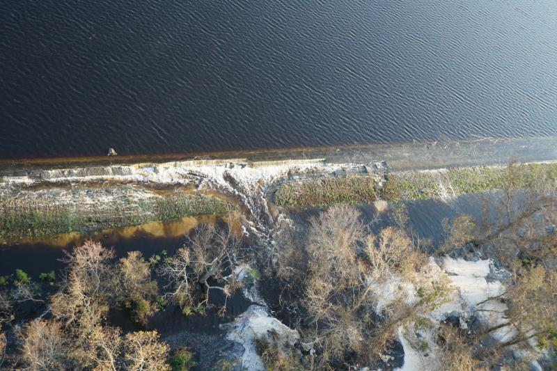 Lightweight coal combustion byproducts could be seen Friday, Friday, Sept. 21, 2018 floating on the top of a lake near Wilmington, N.C., and entering the Cape Fear River.