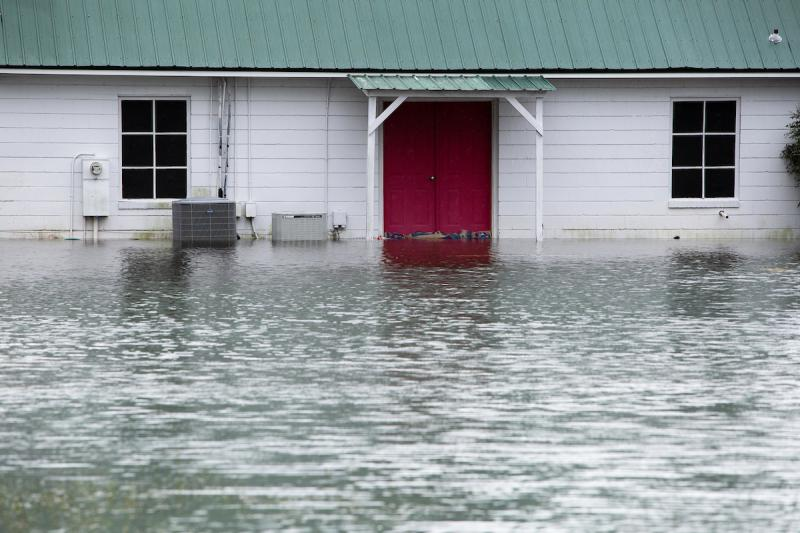 File photo of rising flood waters brought on by Hurricane Florence that threatened a building off highway 70 in Goldsboro, N.C., Sunday, Sep. 16, 2018.