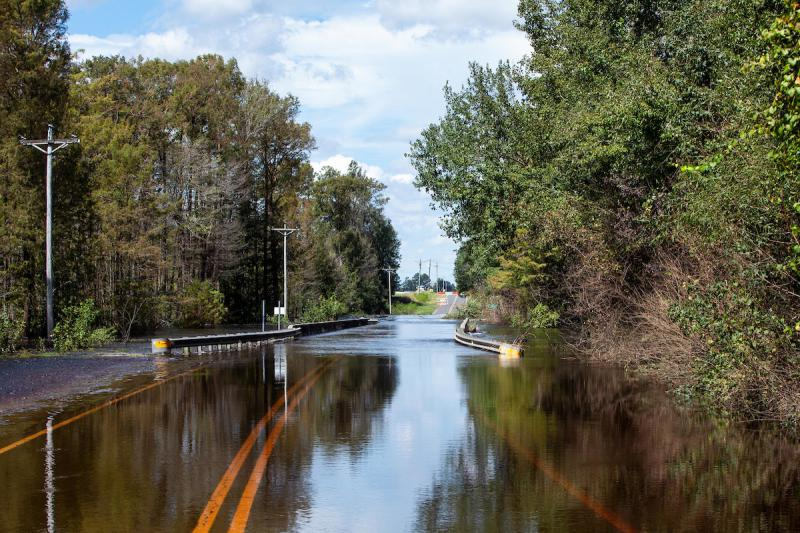 Water from the South River flows over Hayes Mill Rd. in Godwin, N.C., several miles northeast of Fayetteville, Tuesday, Sep. 18, 2018.