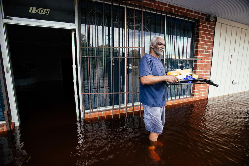 Michael Thomas removes items from his Masonsonic Lodge as flood waters from the Cape Fear River rise following Hurricane Florence in Fayetteville, N.C., Tuesday, Sep. 18, 2018.