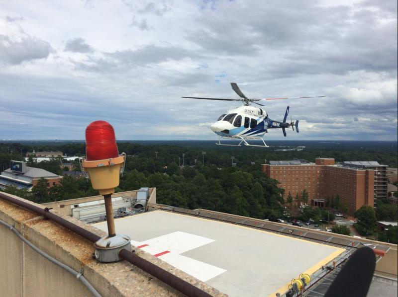 UNC Carolina AirCare helicopter lands to pick up a pediatric team from UNC Hospitals. The crew will then pick up a neonatal patient from Cape Fear Valley Medical Center in Fayetteville, where the Cape Fear River flooded.