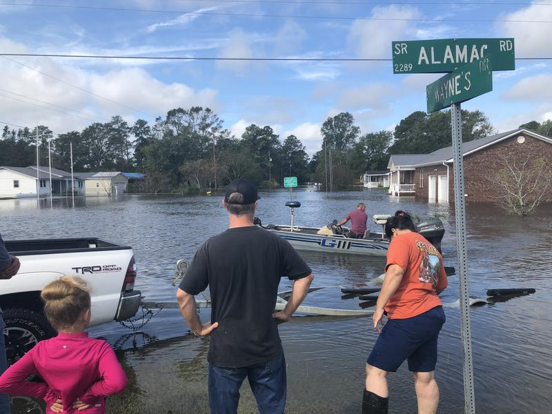 Neighbors in a small, unnamed neighborhood on the southern edge of Lumberton. came back to make a first check of their homes on Monday, Sept. 17, 2018. They