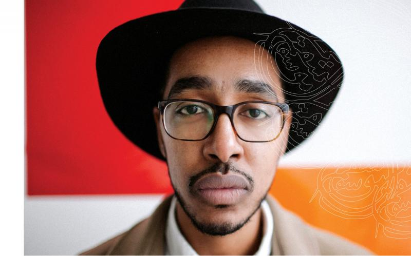 Headshot of Oddisee in a hat