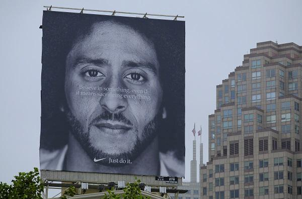 A large billboard showing Colin Kaepernick stands on top of the building housing the Nike store at Union Square Wednesday, Sept. 5, 2018, in San Francisco. An endorsement deal between Nike and Colin Kaepernick prompted a flood of debate.