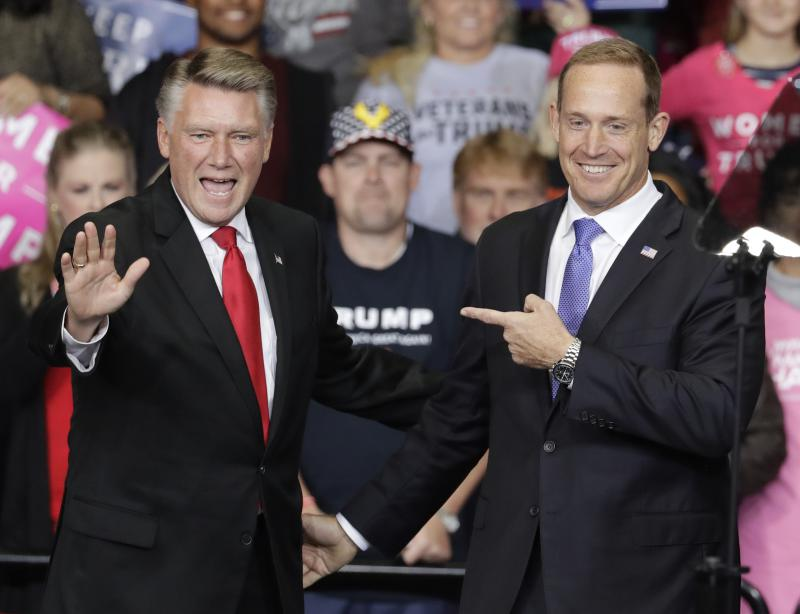 Rep. Ted Budd, R-NC, right, points to Republican congressional candidate Mark Harris, left, during a campaign rally in Charlotte, N.C., Friday, Oct. 26, 2018.