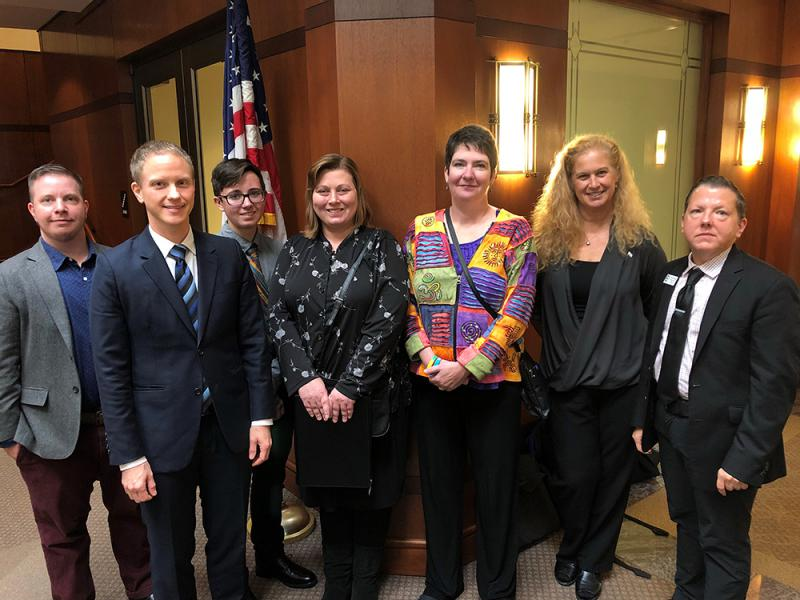 Transgender advocates were available outside the State Health Plan Board of Trustees meeting in Raleigh on Oct. 22, 2018. From left to right: Max Kadel, Noah Lewis, Connor Thonen-Fleck, Alexis Thonen, Deborah Thomson, Jeanne Duwve, Ames Simmons.