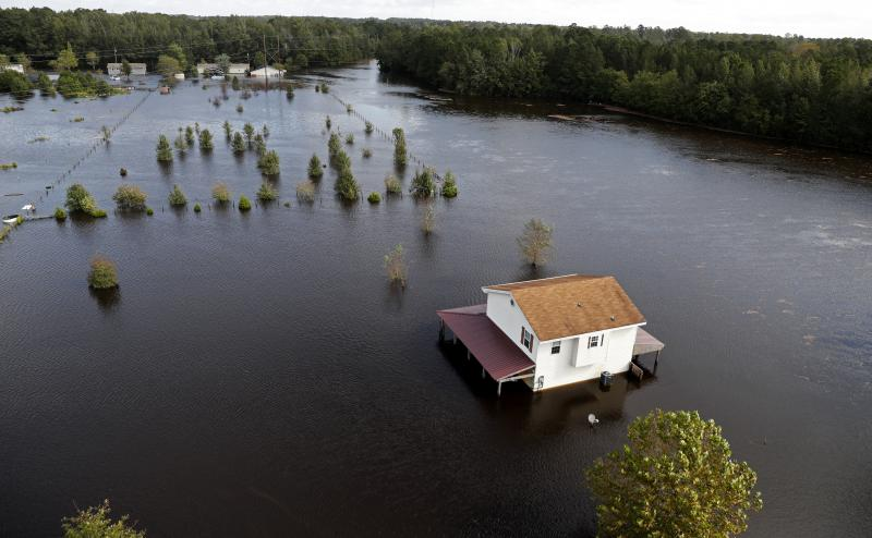A house is surrounded by floodwaters from Hurricane Florence in Lumberton, N.C., Monday, Sept. 17, 2018.