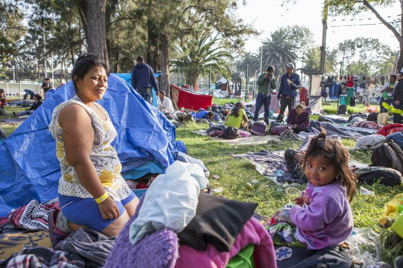 Norma and her daughter Yesica Carolina are getting their day started at a migrant camp in Mexico City. They have come from Copan, Honduras, and she says they are fleeing because her husband was murdered by local gangs.