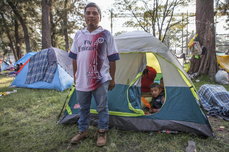 Jaime from Guatemala stands in front of his tent by the Estadio Jesús Martínez 'Palillo' in Mexico City. His wife and two sons are inside the tent. Jaime is worried how his sons would survive the growing violence in his hometown if he were to stay.