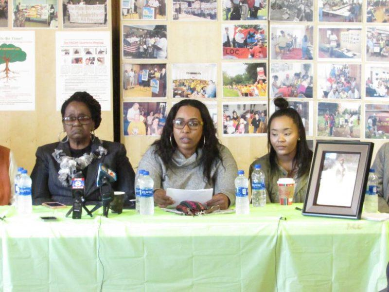 Photo of Kay Suber, Marcus Smith's sister, addresses the media. At left is Smith's mother, Mary Smith.