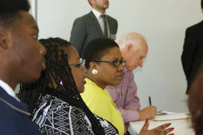 Former high school business teacher and current teacher advisor to the governor LaTanya Pattillo seated next to students in her Innovation, Research and Development class who worked on a project with the manufacturer Ply Gem as part of Patillo's professio