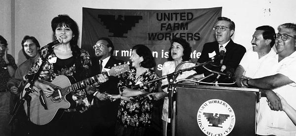 Musician Tish Hinojosa supporting the United Farm Workers' grape strike. Her decades-long career in music features an array of social justice themes.