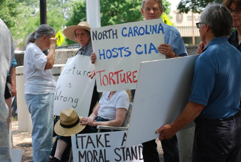 Photo of More signs from NC Stop Torture Now Protest