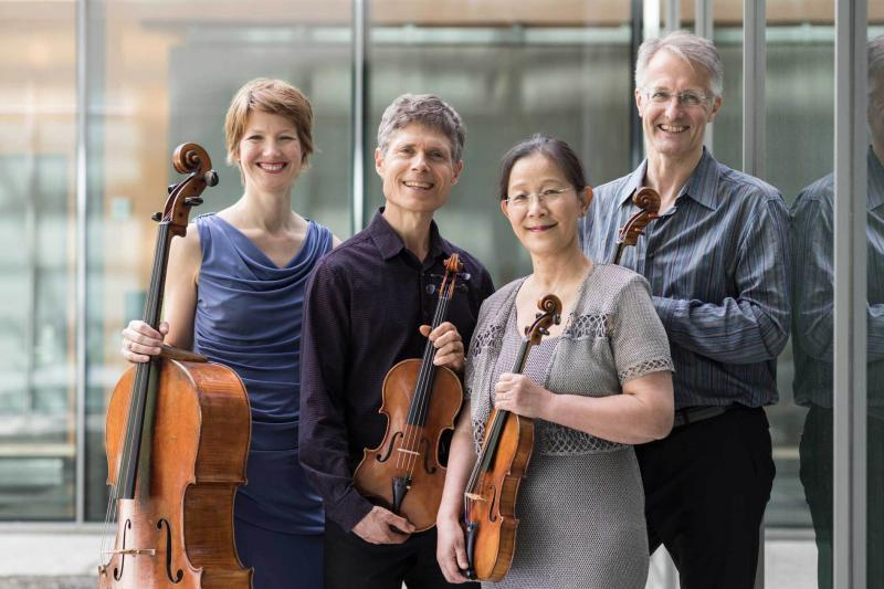 The Ciompi Quartet of Duke University pictured with their instruments.