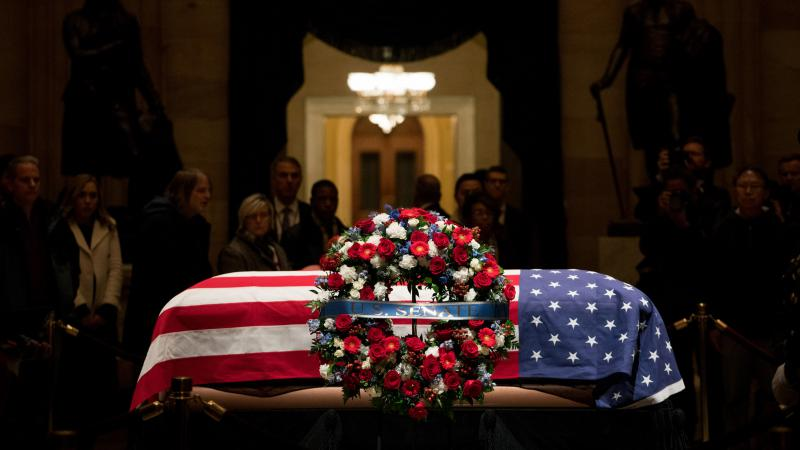 The flag-draped casket of former President George H.W. Bush as he lies in state inside the Capitol Rotunda in Washington D.C.