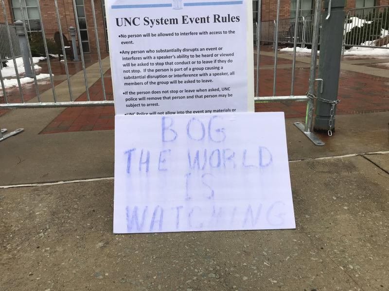 A sign outside the UNC Board of Governors meeting on Dec. 14, 2018.