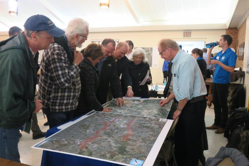 Rickey Langley with the North Carolina Department of Health and Human Services shows residents where PFOS and PFOA has been found at a recent public information meeting.