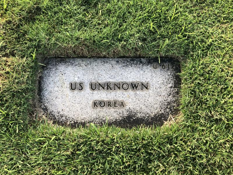 The grave of an unknown U.S. service member at the National Memorial Cemetery of the Pacific in Honolulu. Hundreds of bodies of unknown soldiers will be exumed as part of a mass identification project.