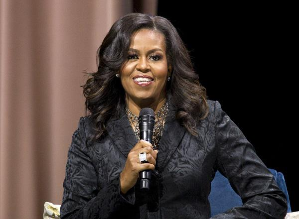"Former first lady Michelle Obama speaks to the audience during a stop on her book tour for ""Becoming,"" in Washington on Sunday, Nov. 25, 2018."